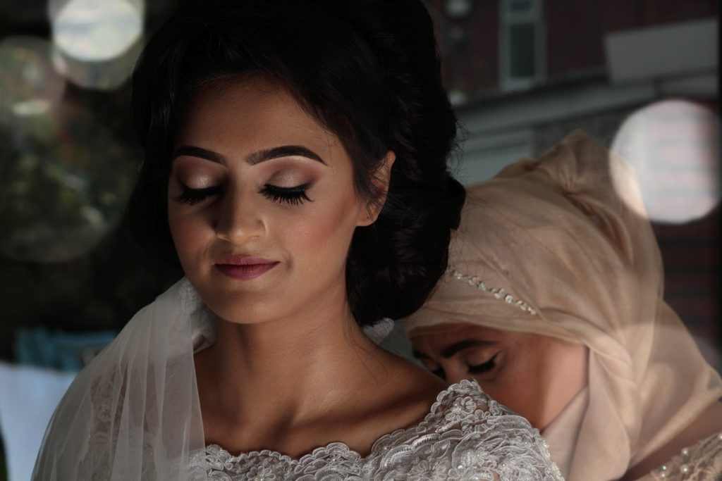 Muslim Bride during Bridal Prep with her Mother.