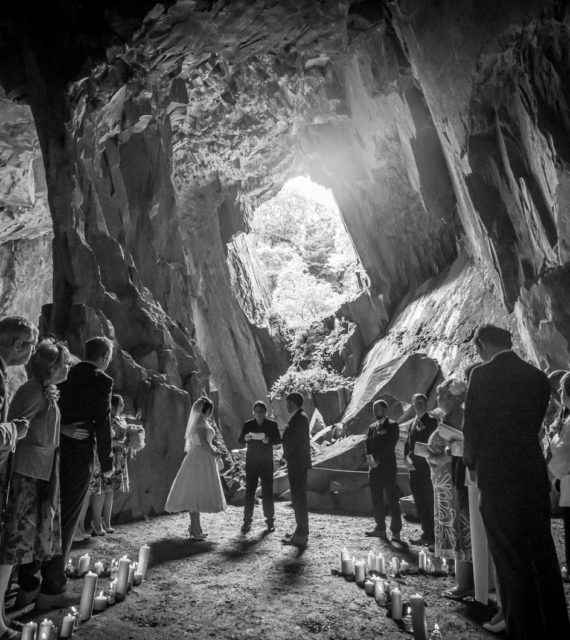 Bride and Groom having their Wedding Blessing in a cave at Cathedral Cavern,Langdale.