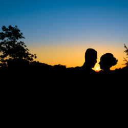 Silhouette of Bride and Groom with the sun setting behind them at Oak Royal Golf and Country Club.