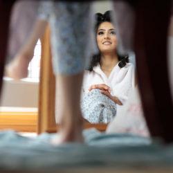 Muslim Bride looking into the mirror during her bridal prep at Preston.