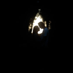 Silhouette of engaged couple with an archway of light behind them at Beacon Fell Country Park.