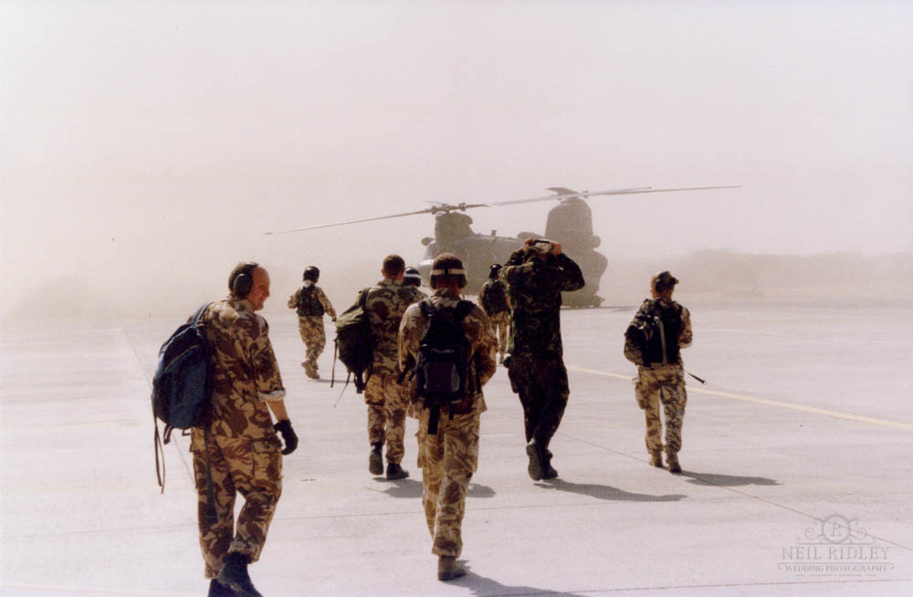 Military personnel boarding a Chinook helicopter in Oman.