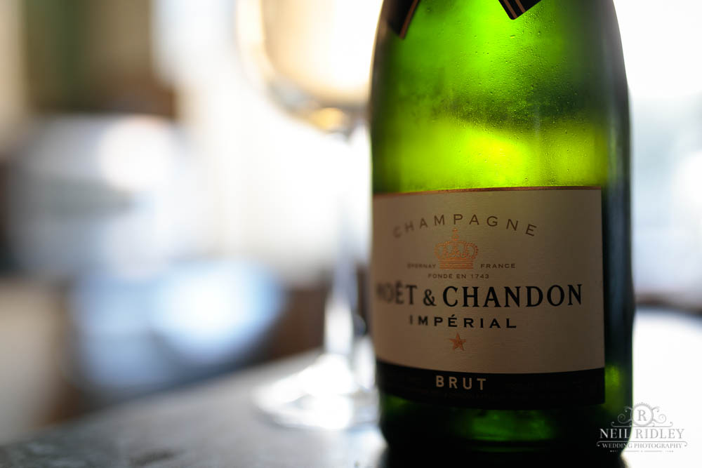 A bottle of Moet & Chandon Champagne sits on a counter during Bridal Prep.