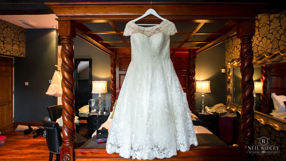 Dress hanging on a four poster bed at at Broadoaks Country Hotel Lake District