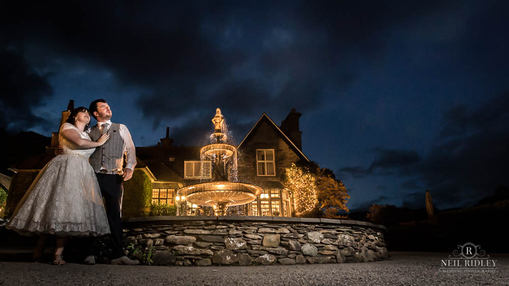 Bride and Groom pose for a nightime portrait at Broadoaks Country Hotel Lake District