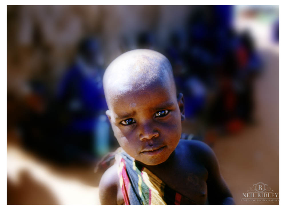 A Massai child looks into the camera lens in Kenya.