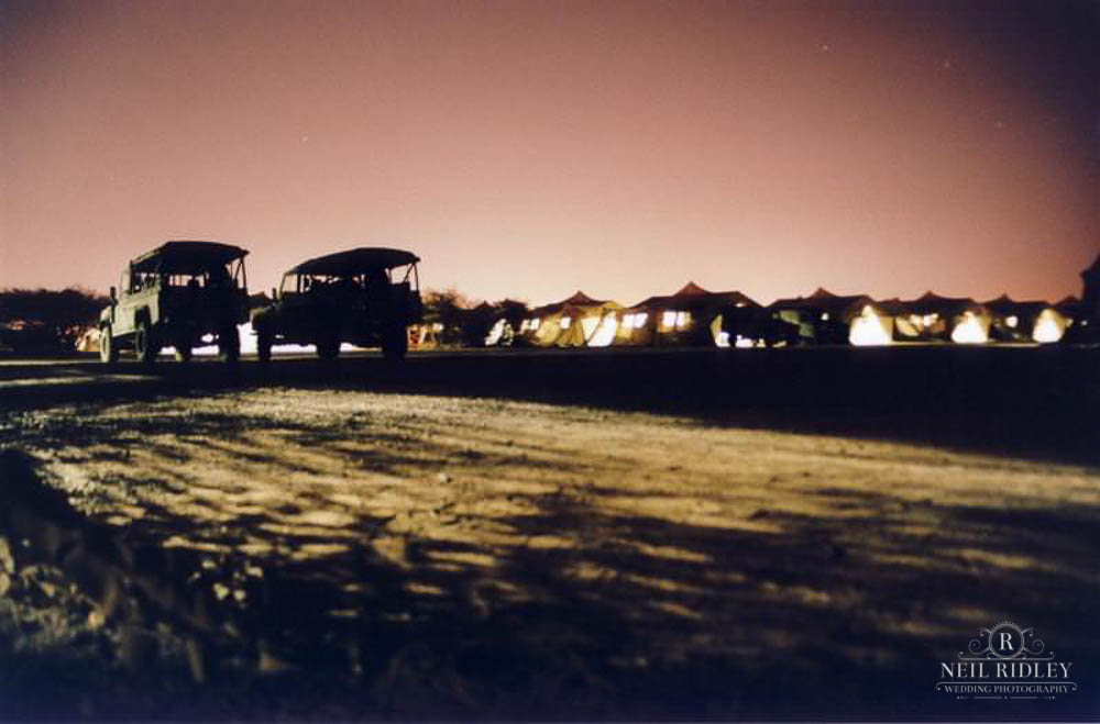British Military Land Rovers and tents at night in Kuwait