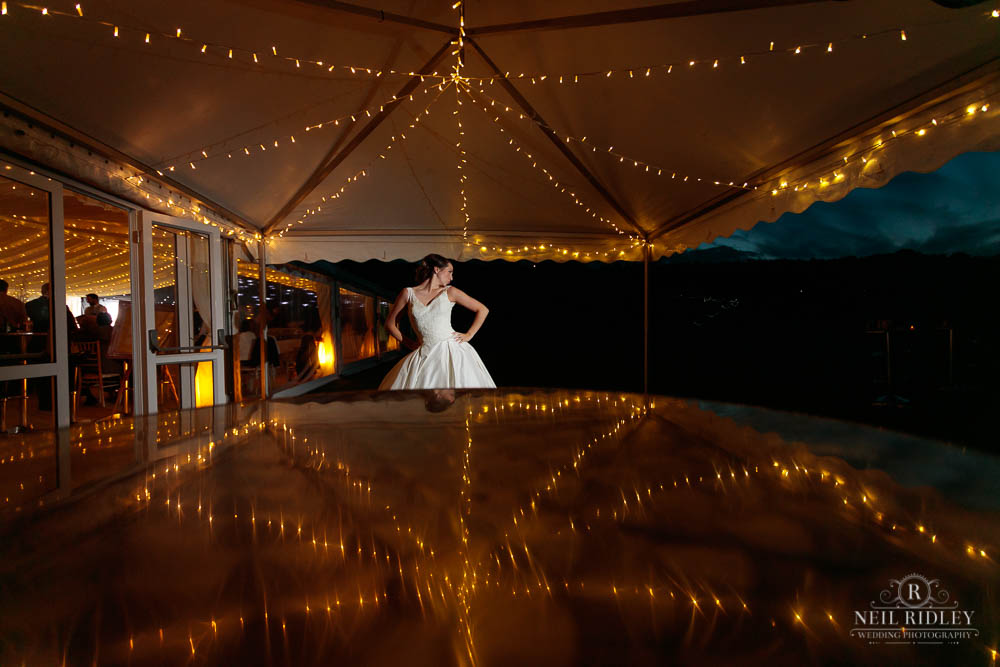 Bride stands outside marquee at Delemere Events
