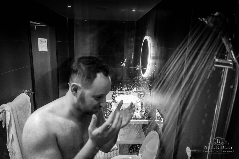 Groom showers before his Jewish Wedding at Groom Prep