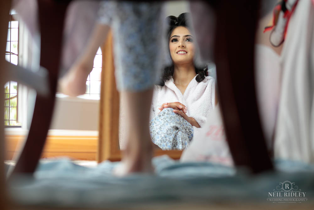 View of the Bride during Bridal Prep from under a chair and into a mirror.