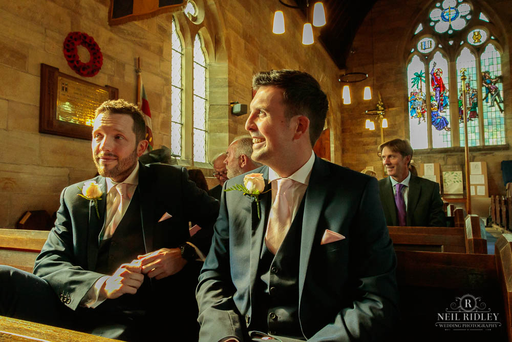 Groom and best man in Church prior to a traditional church wedding.