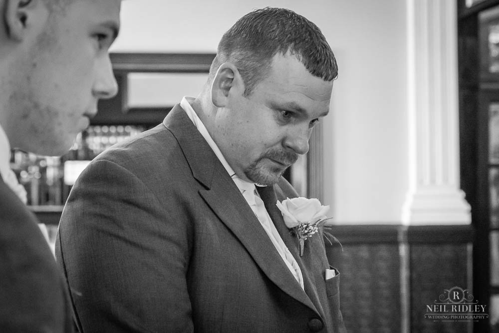 groom waiting for his Bride at the alter.