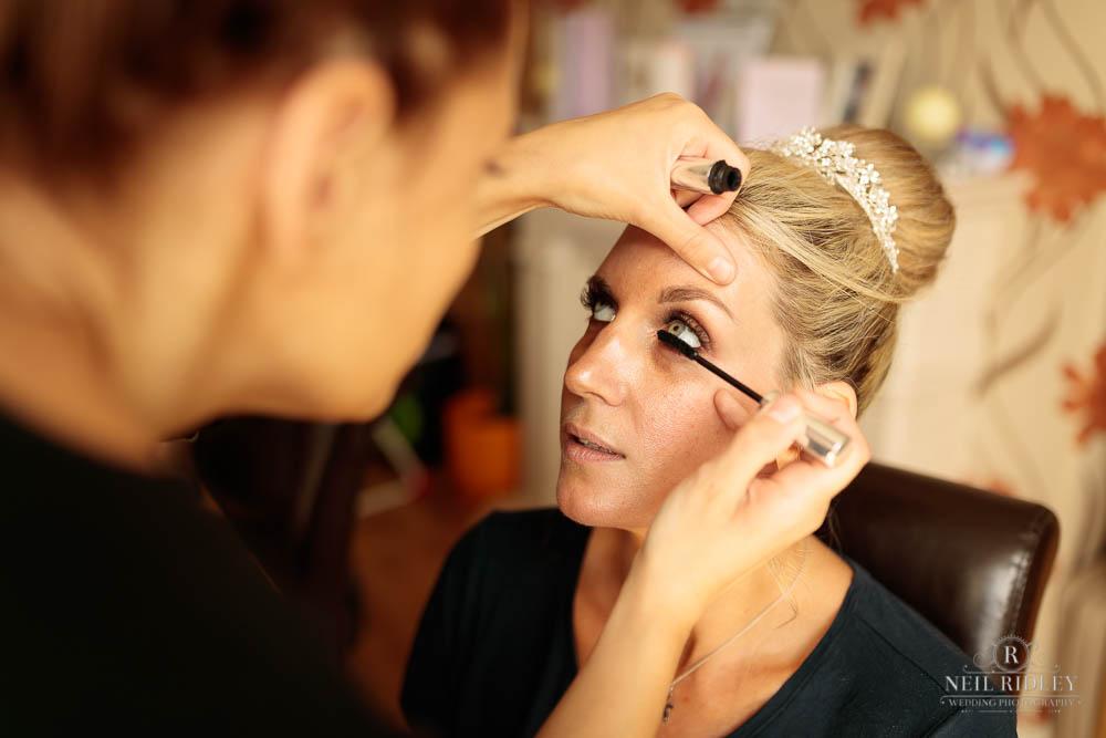 Bride having her mascara applied during Bridal Prep.