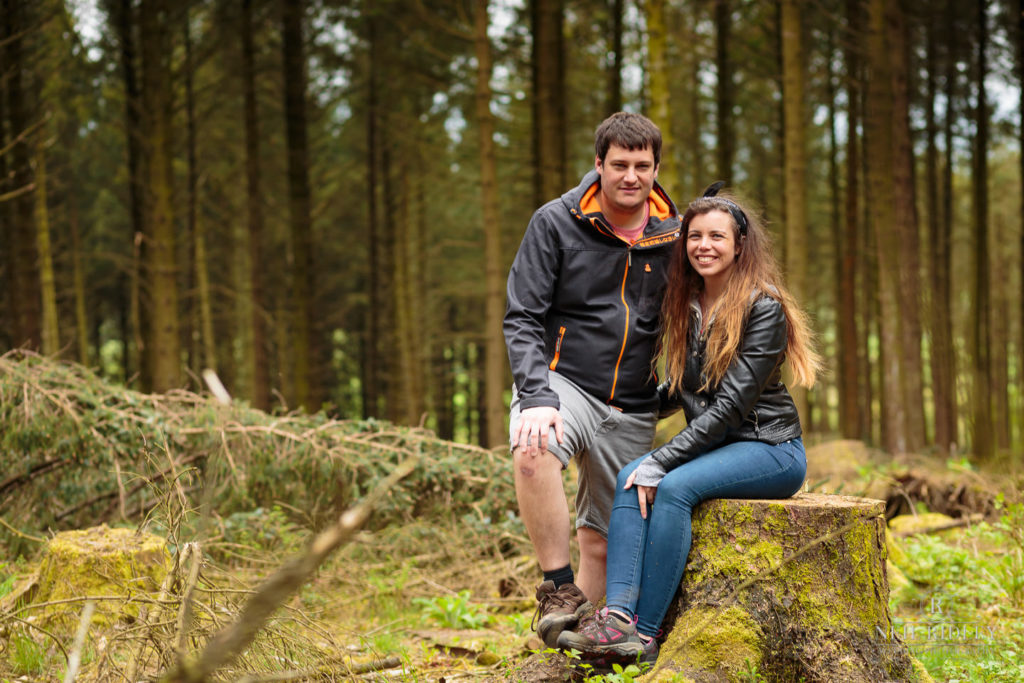 Lancashire Pre Wedding at Beacon Fell, a young couple embrace in a clearing