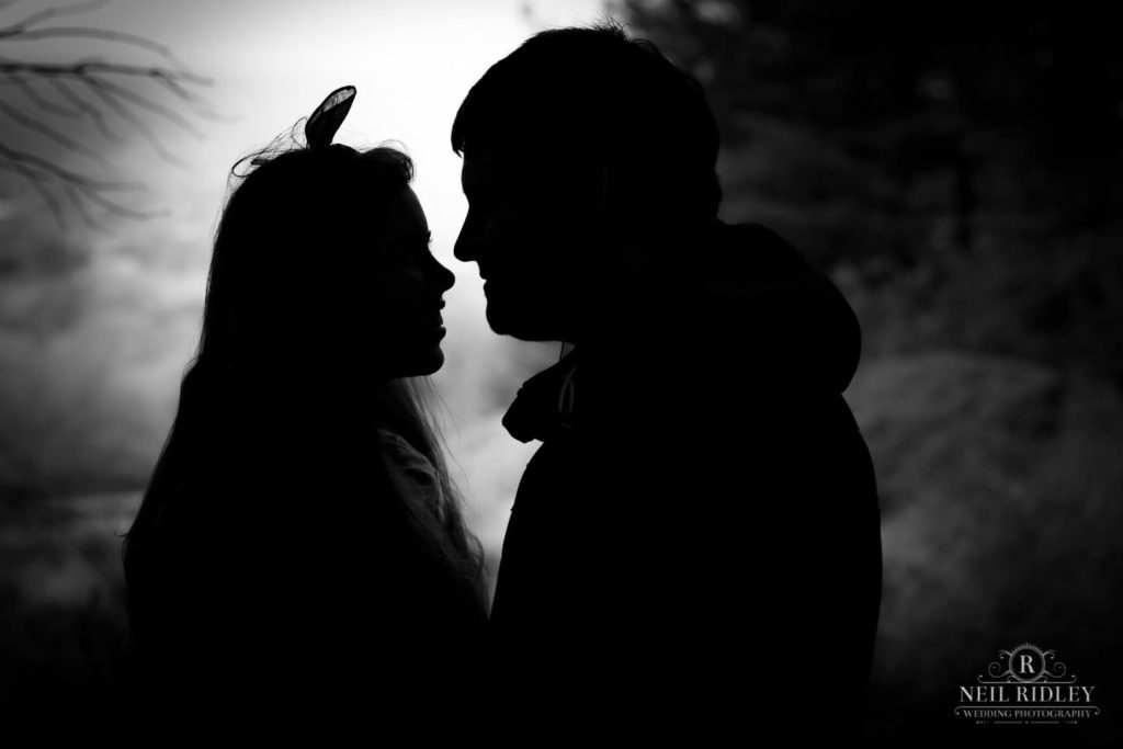 Lancashire Pre Wedding at Beacon Fell, a young couple in silhouette and black and white