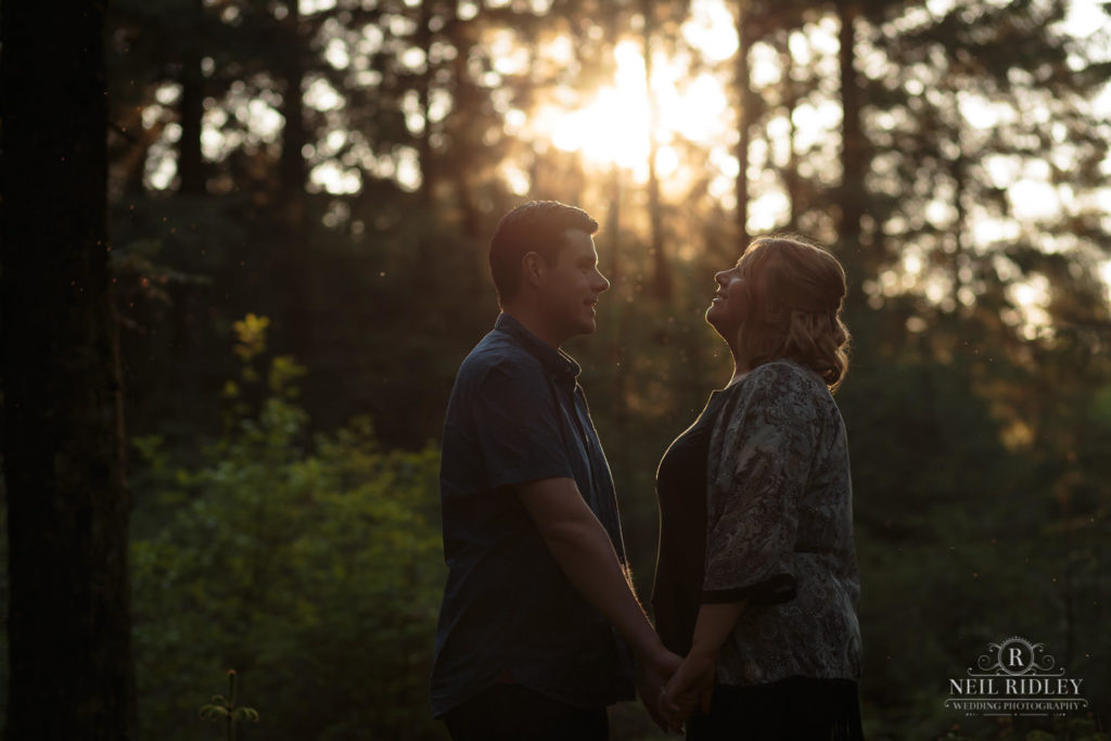 Lancashire Pre Wedding Shoot at Beacon Fell, Young couple in a forest surrounded by golden light