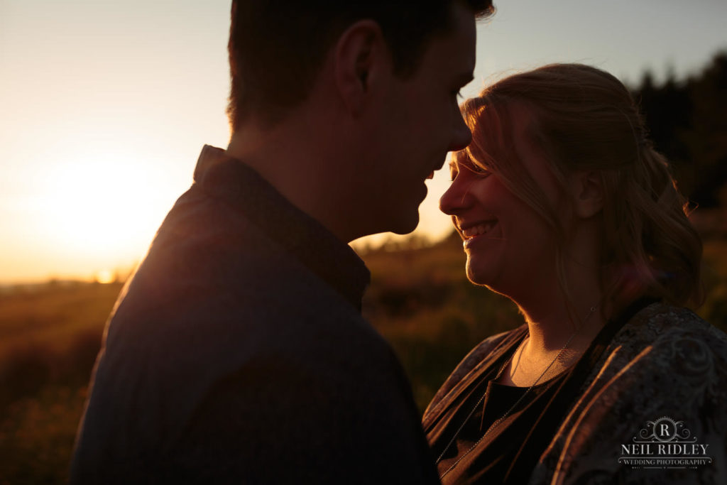 Lancashire Pre Wedding Shoot at Beacon Fell, Young couple side lit by sunset