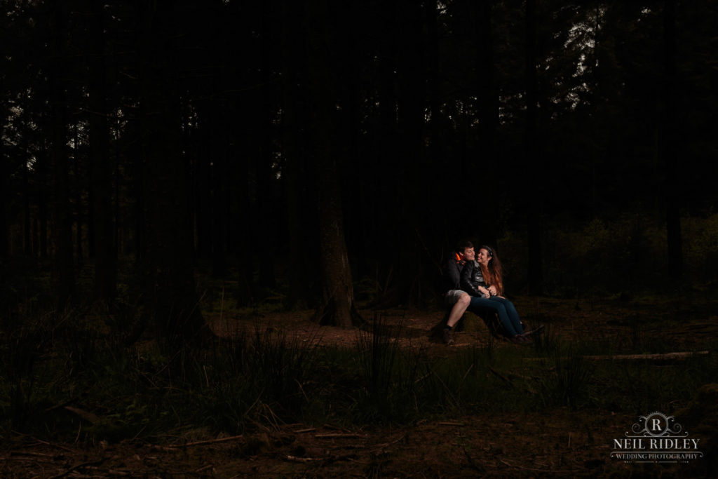 Lancashire Pre Wedding at Beacon Fell, a young couple in a dark forest