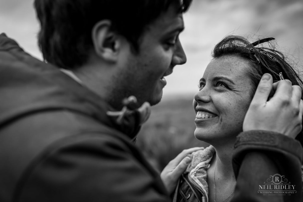 Lancashire Pre Wedding at Beacon Fell, a young man brushes the hair from a ladies face
