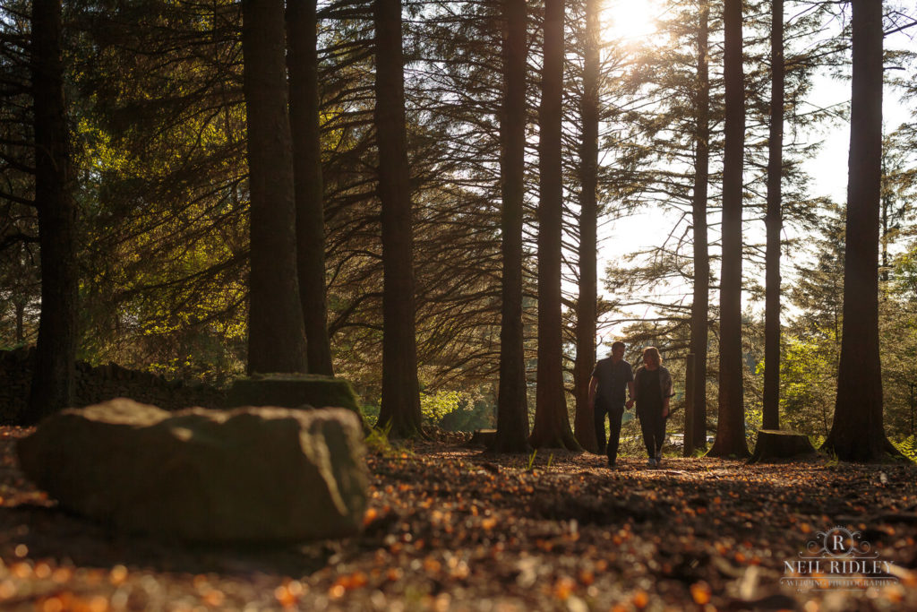 Lancashire Pre Wedding Shoot at Beacon Fell, Young couple walking through a forest