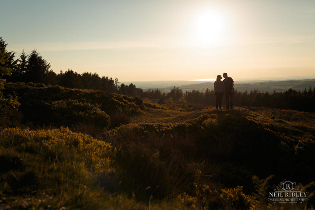 Lancashire Pre Wedding Shoot at Beacon Fell, Young couple in silhouette on top of a hill
