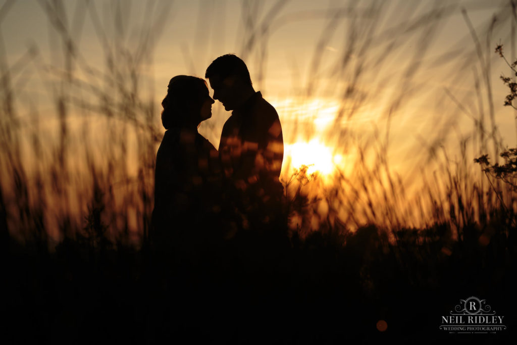 Lancashire Pre Wedding Shoot at Beacon Fell, Young couple in silhouette through reeds