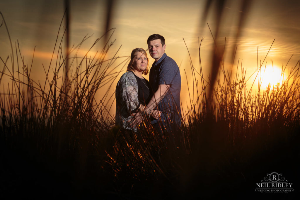 Lancashire Pre Wedding Shoot at Beacon Fell, Young couple pose at sunset
