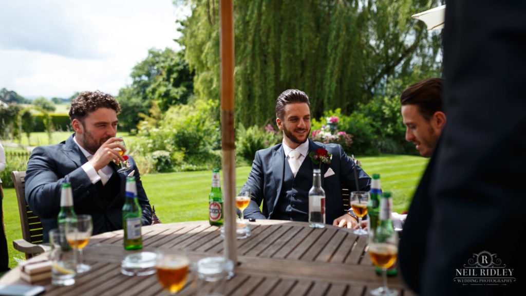 Albright Hussey Wedding Photographer, Groom drinking in the gardens at Albright Hussey Manor