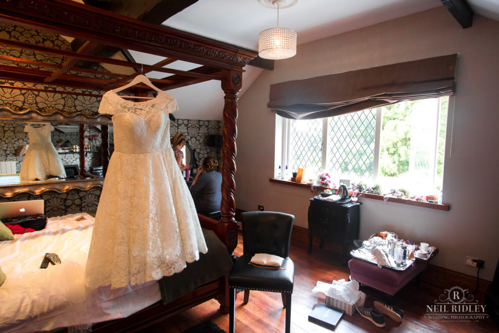 Wedding Gown hanging from a four post bed at Broadoaks Country Hotel