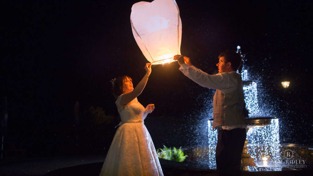 Bride and Groom release a Chinese lantern at Broadoaks Country Hotel