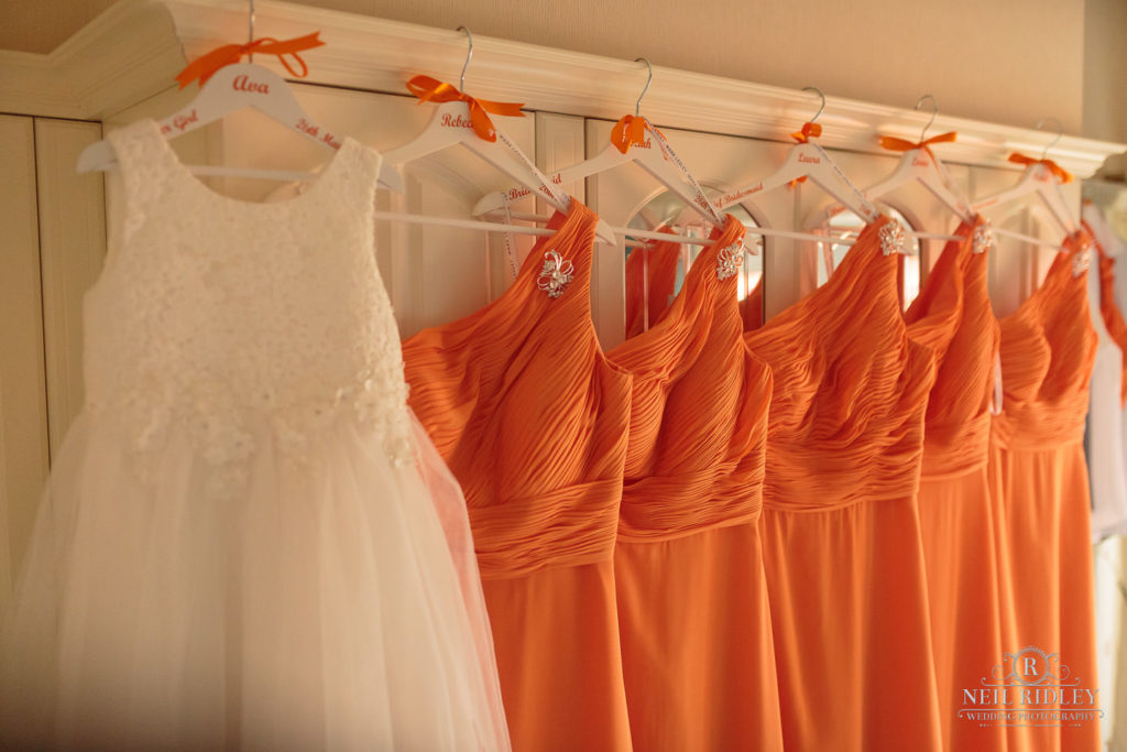 Bridesmaid dress hung up on wardrobe doors