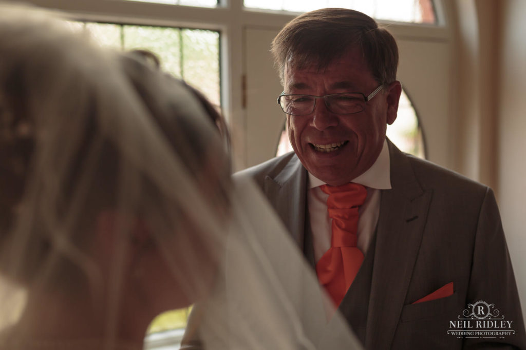 Brides Father after seeing his daughter in her wedding dress for the first time