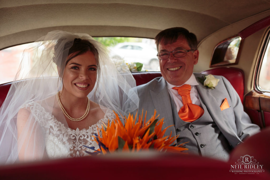 Bride and her Father in her Wedding Car