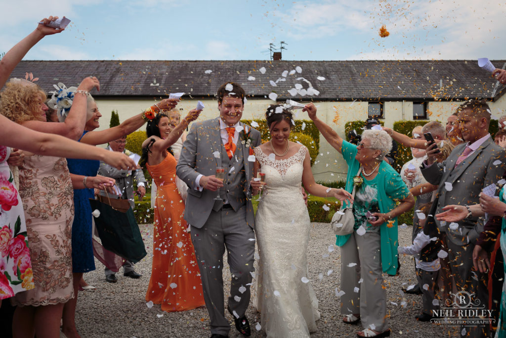 Bride and Groom arrive to a Confetti shower at The Great Hall of Mains