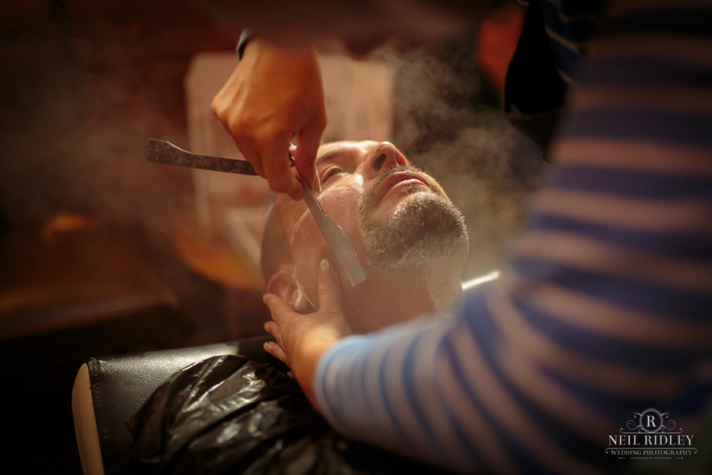 Groom has a professional Wet shave with cut throat razor at Barbers in Bispham