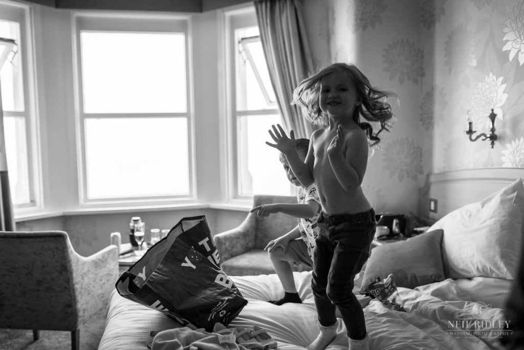 Children jump on the bed during Bridal Prep at The Park House Hotel, Blackpool