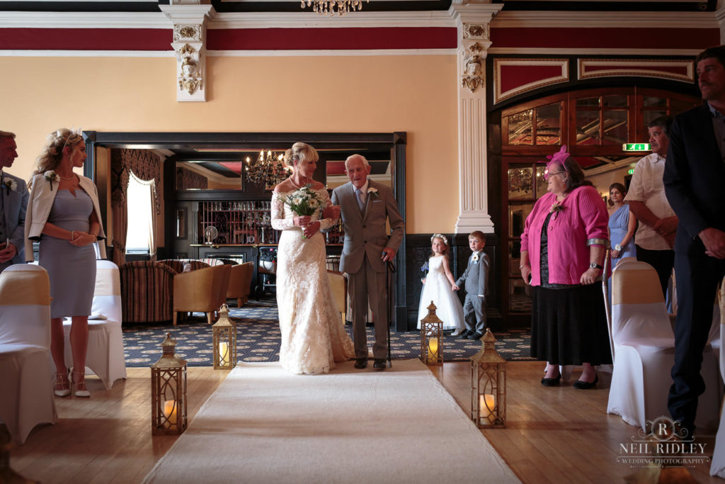 Bride ios walked down the aisle by her father at The Park House Hotel, Blackpool