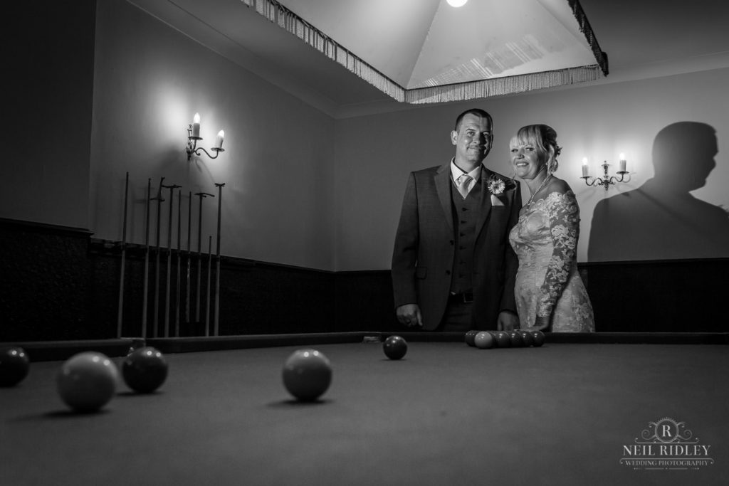 Black and white image of bride and Groom next to a snooker table at The Park House Hotel, Blackpool