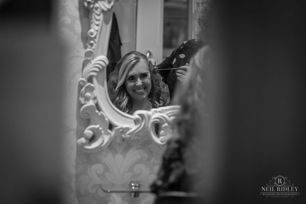 Lancaster Wedding Photographer - Black and white image of bride at the hairdressers with her reflection in the mirror at Lancaster House Hotel