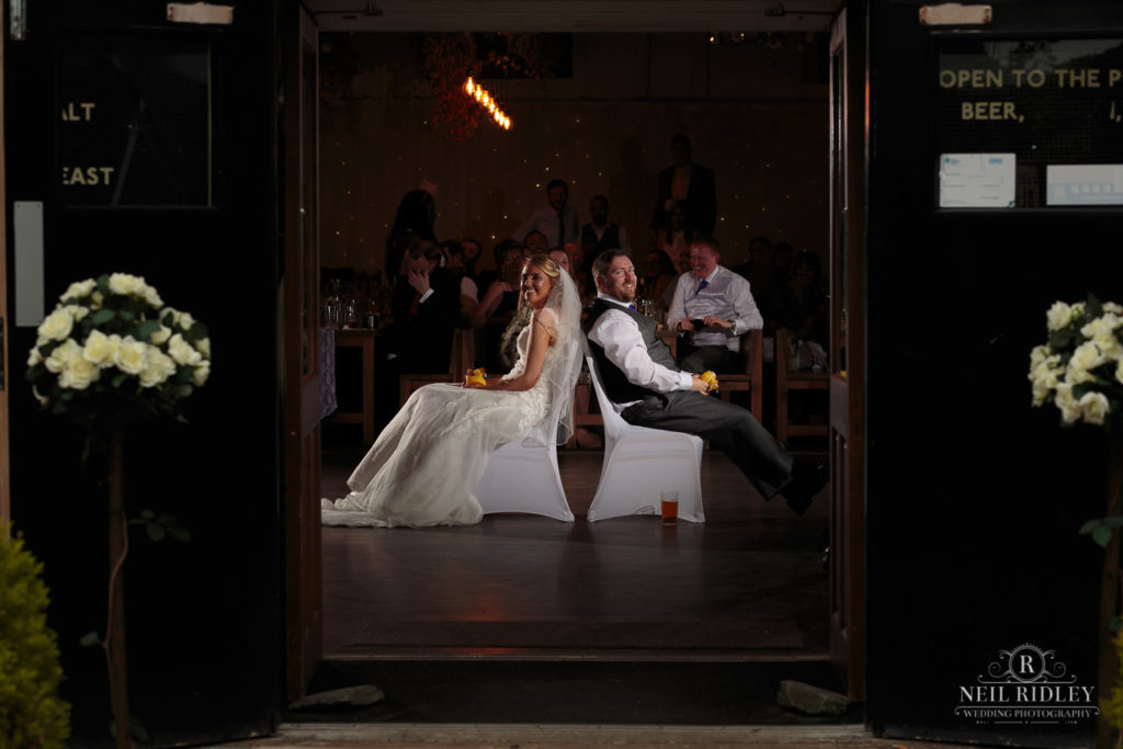 Lancaster Wedding Photographer - Bride and Groom have a game of Mr & Mrs at Lancaster Brewery
