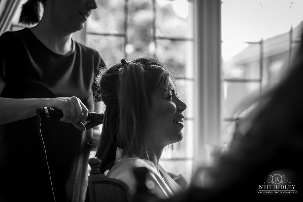 Bride has hair done during bridal prep by Saks of Lytham