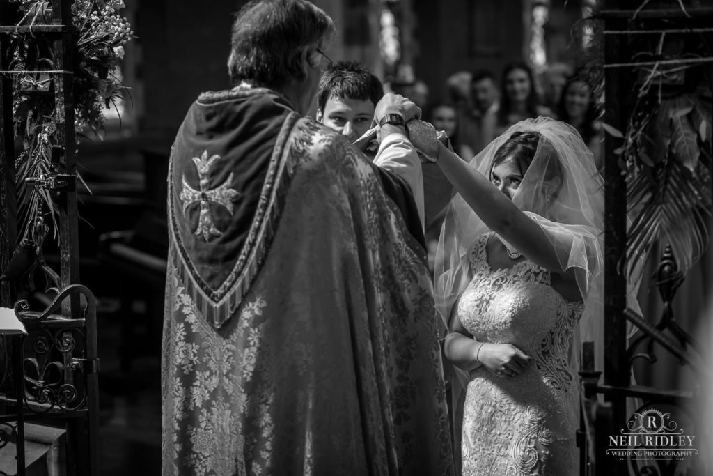 Black and white image of Bride and Groom at the Altar at St Thomas Church in St Annes-on-Sea