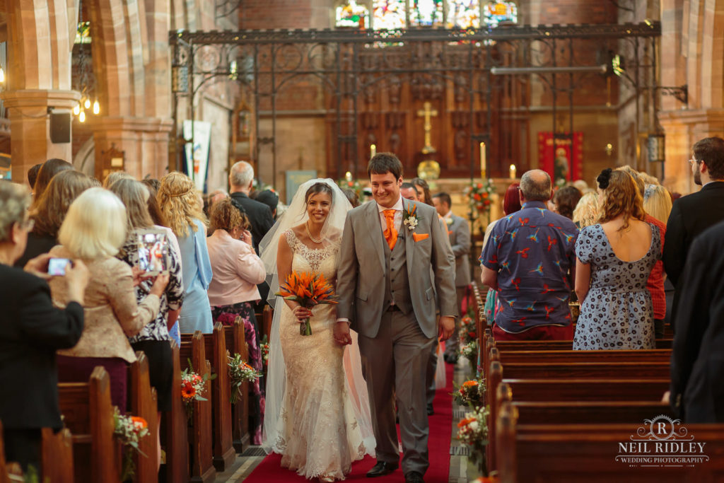 Bride and Groom leave St Thomas Church in St Annes-on-Sea