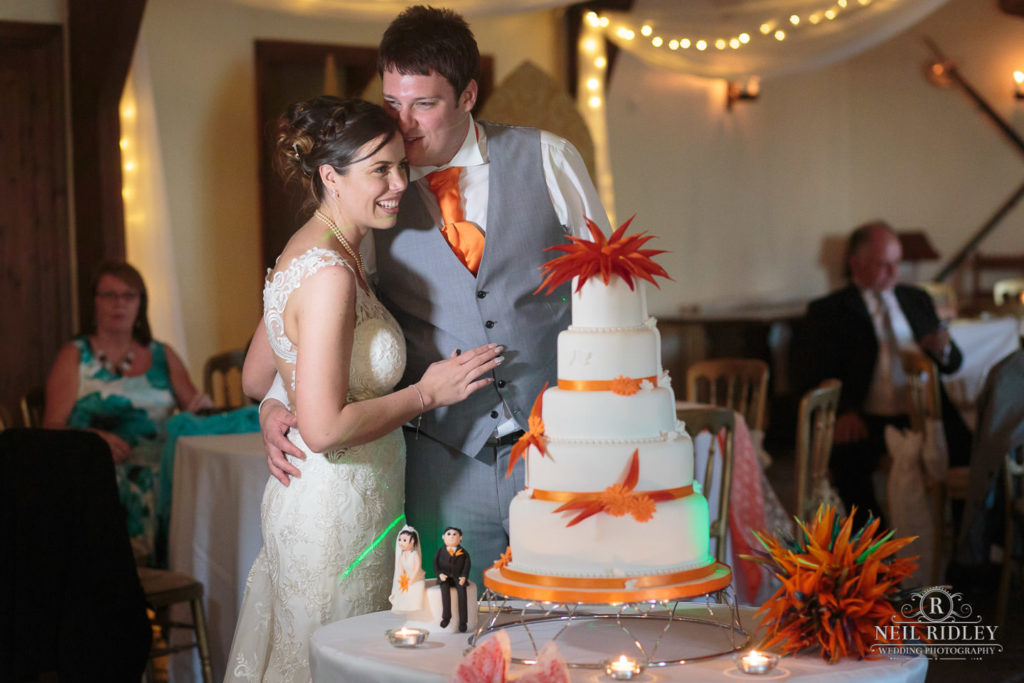 Bride and Groom cut the cake at The Great hall Of Mains