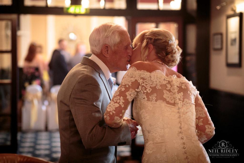 Bride kisses her Father after he has walked her down the aisle at The Park House Hotel, Blackpool