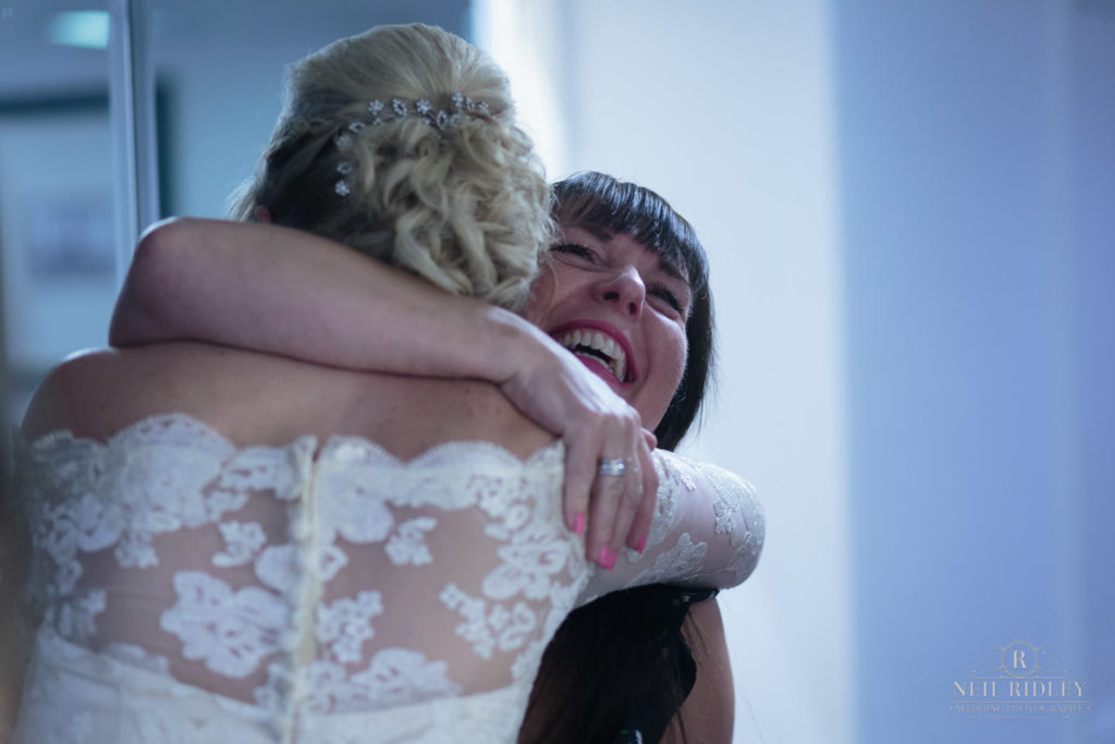 Bride hugs wedding guest at The Park Hotel, Blackpool