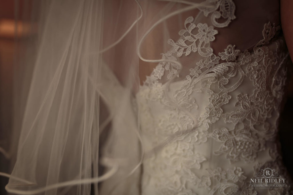 Lancaster Wedding Photographer - Back of Bride's wedding dress with veil at Lancaster House Hotel