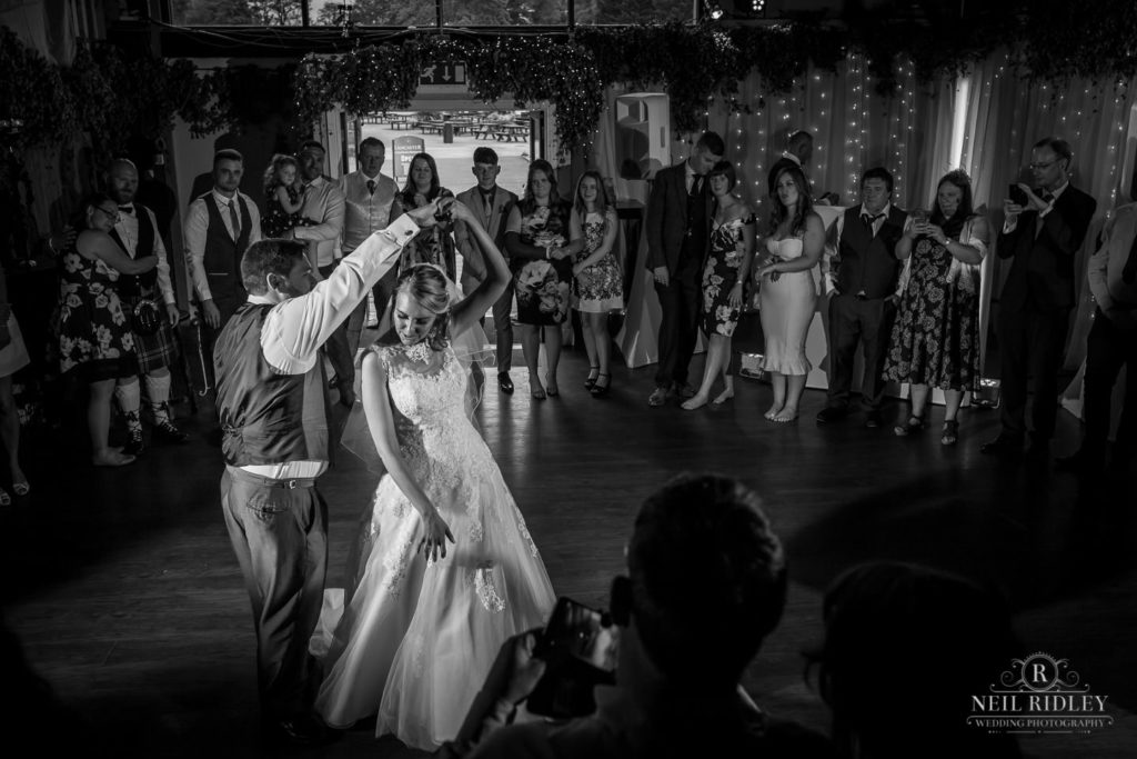 Lancaster Wedding Photographer - Black and White image of bride and Groom enjoying their First Dance at Lancaster Brewery