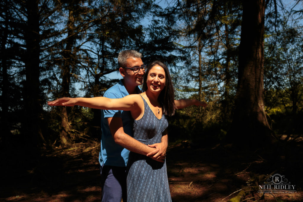 Engagement Shoot Couple re-enact a scene from Titanic in the forest at Beacon Fell Lancashire