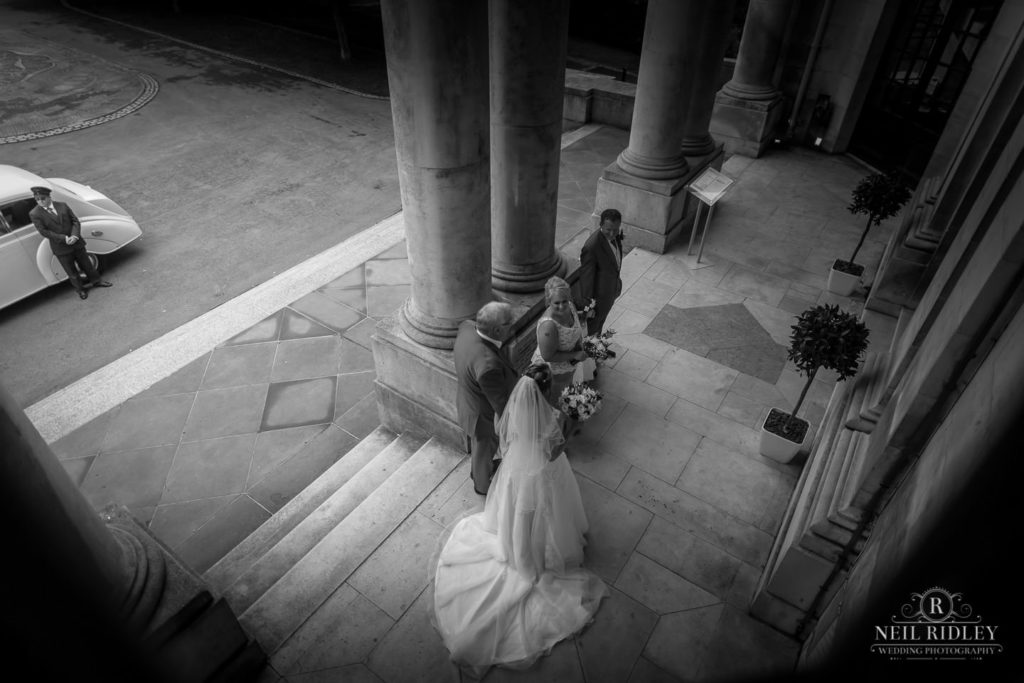 Lancaster Wedding Photographer - Black and white image of bride and her bridesmaids waiting to go in Ashton Memorial, Lancaster
